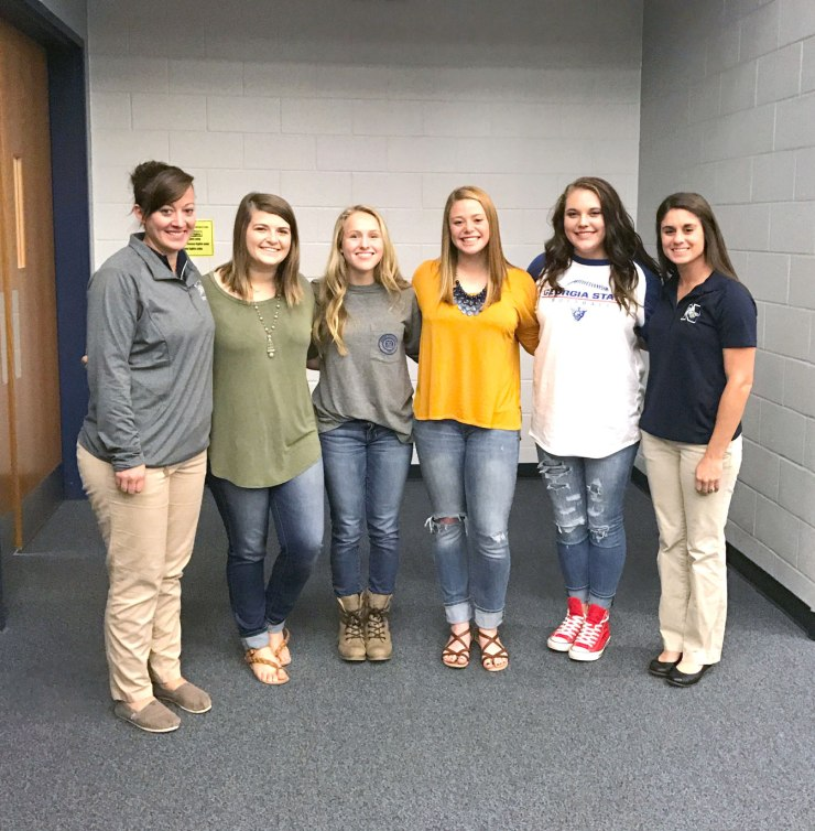 Coach Suzannah Seal, Shay Sullins, Brooke Whittemore, Meagan Coltrane, Alyssa Brumelow, and Coach Jennifer Maloney at Signing Day.