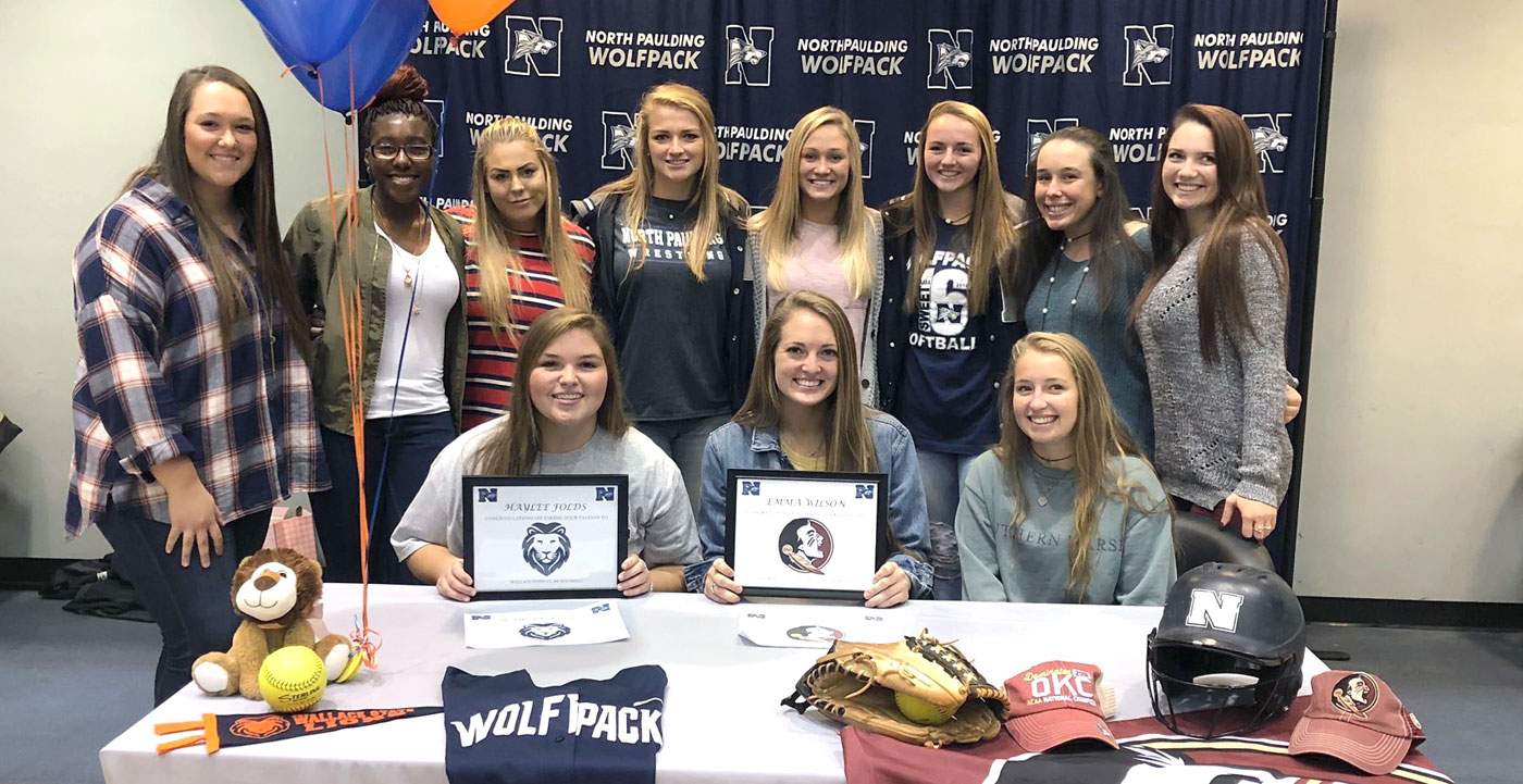 NPHS Softball team celebrates college signings.